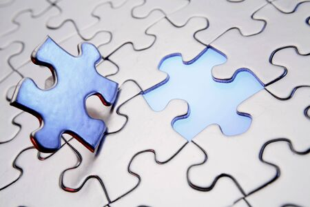 final piece of puzzle: Final piece to complete jigsaw puzzle    Stock Photo