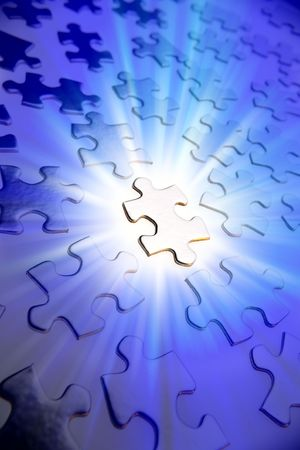 puzzle shape: Jigsaw puzzle pieces. One brightly lit. Blue tone.    Stock Photo