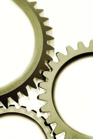 Close-up of three steel gear wheels photo