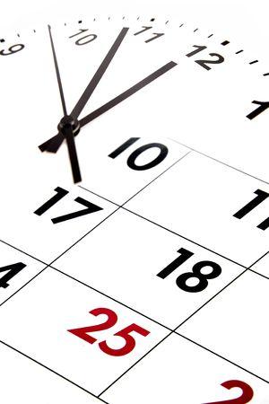 Calendar blending into clock face. photo
