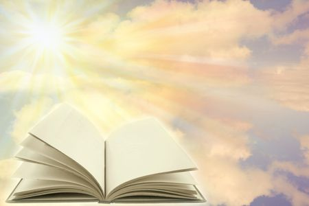 scripture: Open book on a heavenly scene. Copy space.   Stock Photo
