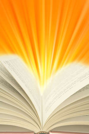 Open book and light rays. Copy space photo