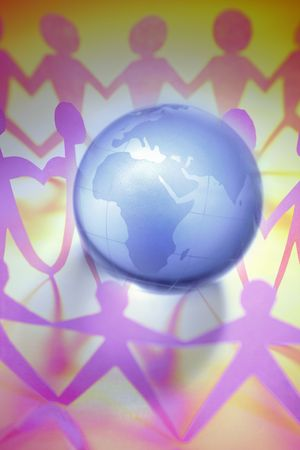 Groups of people holding hands around globe. Stock Photo - 5749379
