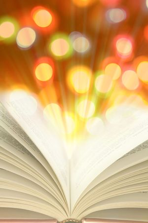 Open book and colorful lights photo