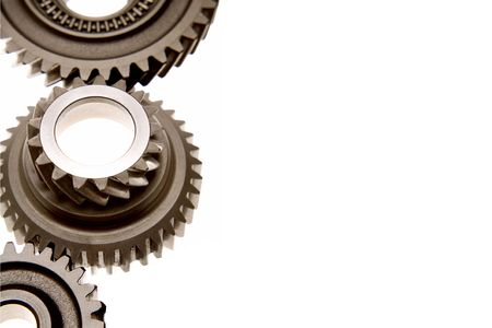 Closeup of three steel gears on white background. Copy space. photo