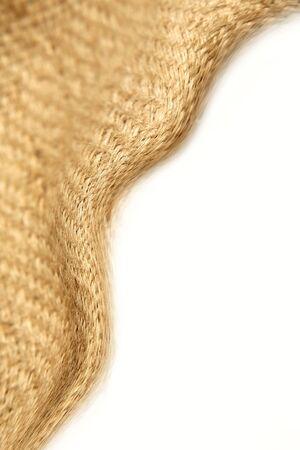 Burlap textile over white background. Copy space.