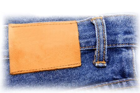 Blank leather label on pair of jeans. Copy space.   photo