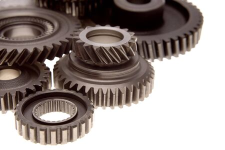 Closeup of steel gears on plain background. Copy space. photo