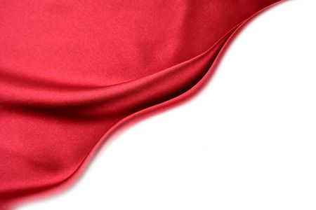 red sheet: Silk material on white background. Copy space.    Stock Photo