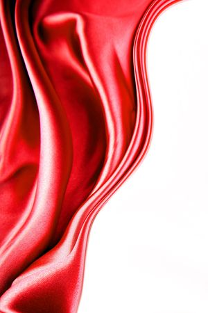 Silk flowing on white background. Copy space. photo