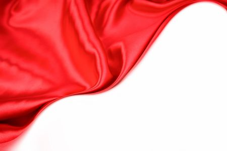 red silk: Silk fabric on white background. Copy space