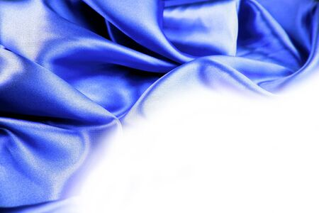 Silk fabric on white background. Copy space photo