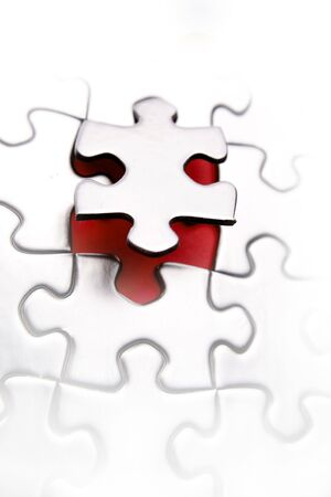 Last piece to complete puzzle on white. Stock Photo - 5832800