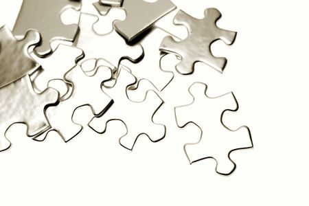 breakaway: Jigsaw puzzle pieces on white
