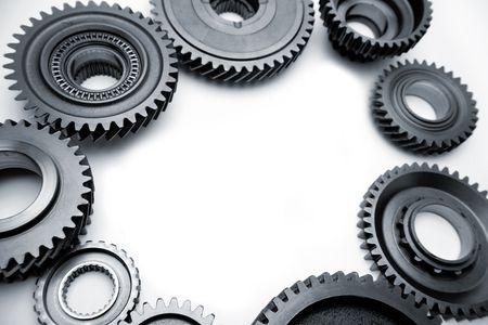 Steel gears on plain background. Copy space photo