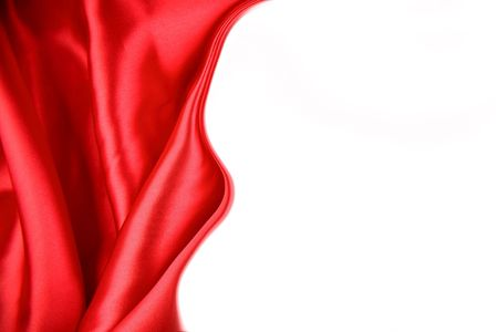 folds: Red silk fabric on white background. Copy space