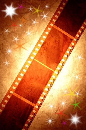 Filmstrip on bright starry background. photo