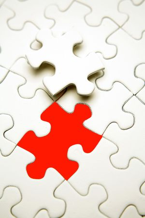 Jigsaw puzzle piece next to red gap. Stock Photo - 5986464