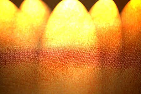 spot lit: Five spotlights shining down onto blank surface. Copy space.