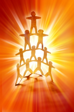 Human team pyramid on bright background. photo