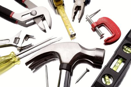 Assortment of tools close-up on white   photo