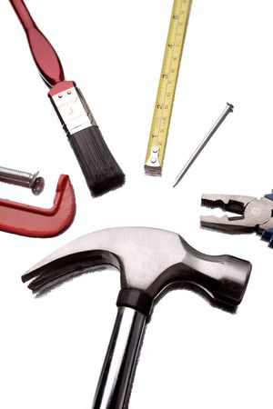 Assorted work tools on white    photo