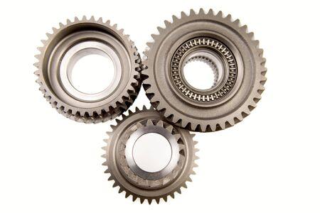 interlocking: Three gears meshing together over white    Stock Photo