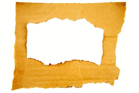 Torn paper on cardboard over plain background   photo