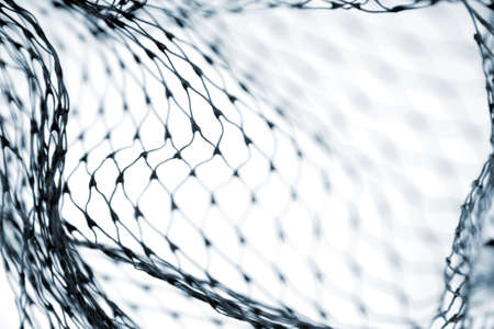 Close-up of netting on white background