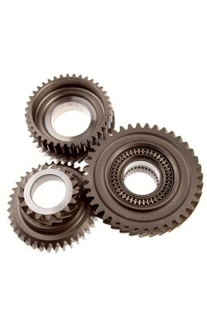 Three metal gears over white photo