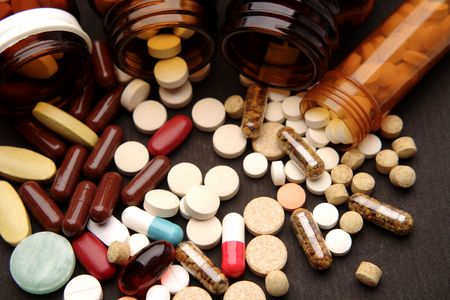 Assortment of pills and capsules photo