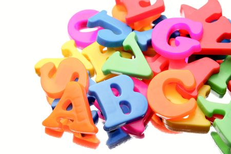 Alphabet letters close-up on white Stock Photo - 7029887