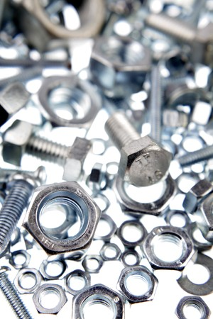 Chrome nuts and bolts close-up photo