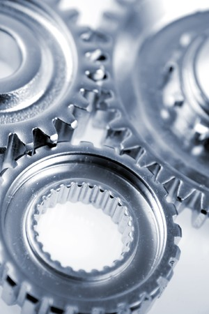 machine teeth: Three metal gears over white