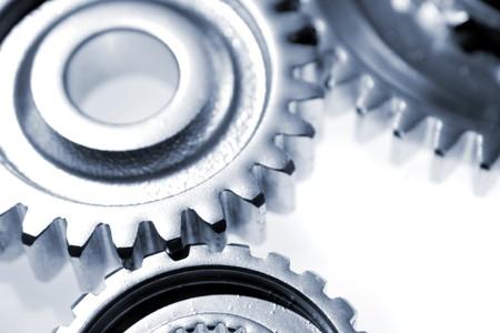 Three metal gears over white Stock Photo - 7342388
