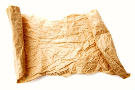 Brown crumpled paper on plain background photo