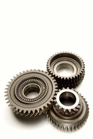 Three metal gears over white Stock Photo - 7363095