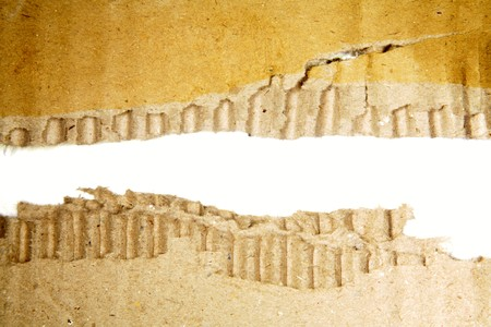 Hole ripped in corrugated cardboard Stock Photo - 7363207