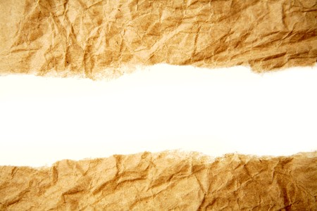 plain backgrounds: Hole ripped in brown paper on white background