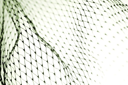 Close-up of netting on white background photo
