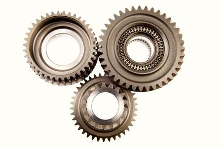 interlink: Three metal gears over white