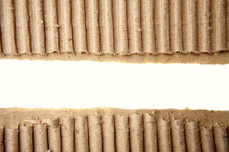 Gap in corrugated cardboard on white background photo