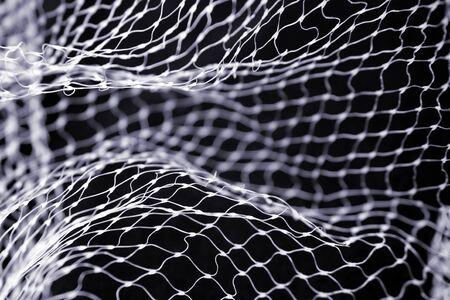 Close-up of netting on black background photo