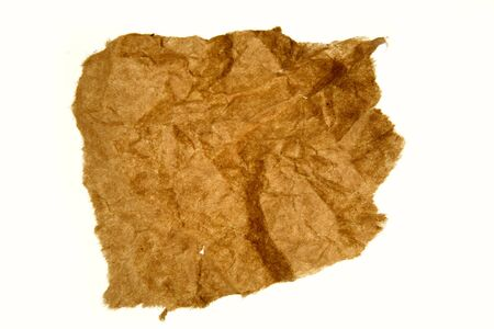 Crumpled brown paper on white background photo