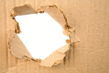 Hole ripped in corrugated cardboard    Stock Photo - 7429009