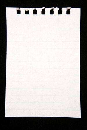 Blank white paper over dark surface photo