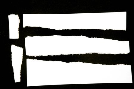 torn: Pieces of torn paper on black  Stock Photo