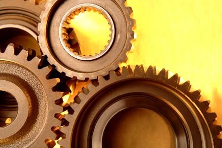 meshing: Closeup of steel gears meshing together  Stock Photo