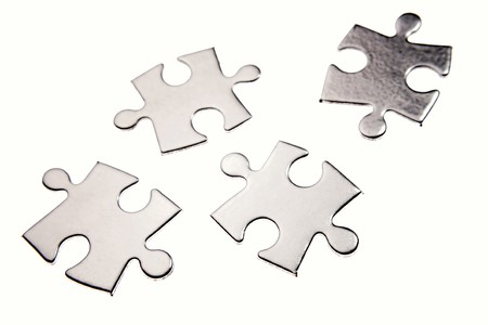 breakaway: Four jigsaw puzzle pieces on white Stock Photo