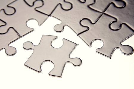 Jigsaw puzzle pieces on white Stock Photo - 7448852